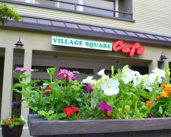 ‪Village Square Cafe‬