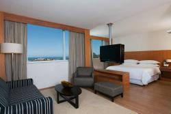 Suite Club Guestrooms at our hotel are spacious and offer great views