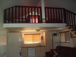 loft area with 2 single beds.