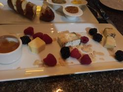 Three cheese plate. Extremely, extremely small portions of cheese for 4 people. Extremely.