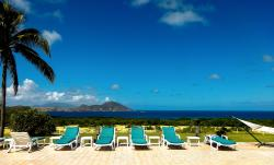 poolside at the luxurious Mount Nevis Hotel; view of St. Kitts
