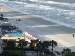 View from our balcony (My husband driving down the beach)