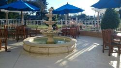 Outdoor seating/smoking area near reception.