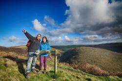 Walkers overlooking the Coleridge Way in Exmoor's famous Doone Valley