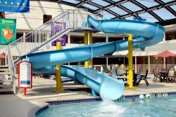 Indoor atrium pool with water slide
