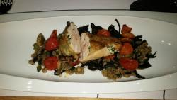 Chicken breast stuffed with garlic butter, millet with trumpet mushrooms and zucchini, ragout of