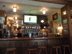 The Curragh's west bar serves patio diners