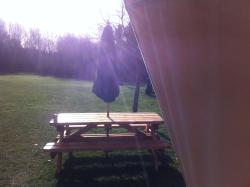 Picnic bench outside the bell tent