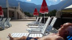 hubby resting by the pool