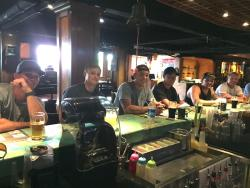 American navy guys are visited Dicey Reilly's aroud the bar with them beer and enjoyed their lun