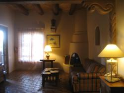 Large Upper Room Interior, with Corner Adobe Fireplace