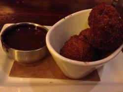 Cornbread hush-puppy style churros with dark chocolate sause