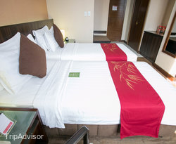 The Deluxe Twin Room at the Ramada Manila Central