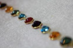 Hand made gold and gemstone bracelet. Blue topaz, Ruby, Citrine, Amethyst..