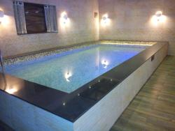 Swimming Pool Under the Bedroom partitioned with Glass Floor
