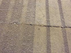 Cuts in the centre of the carpet