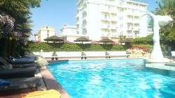 View of the pool looking towards the hotel next door