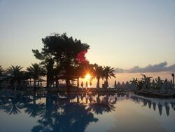 sunrise behind the pool