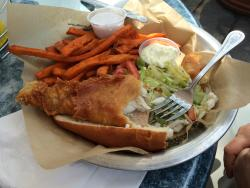 Half of the Walleye Sandwich, with the Sweet Potato Fries and dip