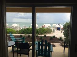 Beachfront patio with beach beyond (view from room)