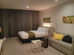 Citadines Bed and living area