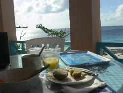 Breakfast on the porch at Grape Bay Cottages