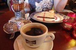 Cake and a small white chocolate treat (Maruccia) with coffee