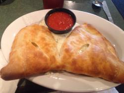 Calzone with properly blended cheeses, sub on homemade roll, and pizza.