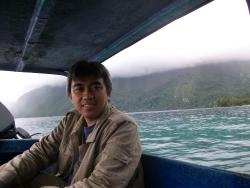 On boat in back of Hatu Saka Mountain, in Manusela National Park