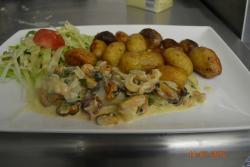 Fricassée de St Jacques accompagnée de pommes de terre starlette de Bretagne