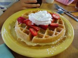 Strawberry waffle and capriccio benedict