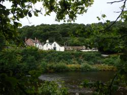 The Grouse Inn from the banks of the River Dee