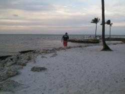 Hubby wandering the beach outside our door.