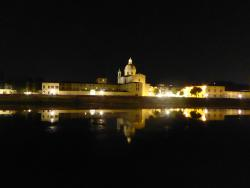 Historical church across the Arno River lights up at night!