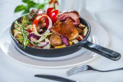 Pork knuckle in a pan