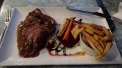 Roast lamb with mint gravy, house vegetable and fries.