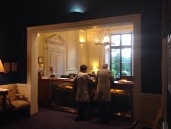 The entrance hall, reception, steak sandwich and bar food menus.