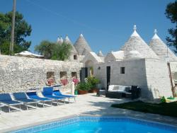 Pool area, trullo del nice bedroom and outside space