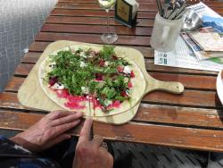 Flammkuchen with goat's cheese, raspberries and rocket