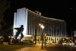 Running man sculpture across from Hilton exterior