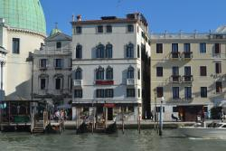 view of the Hotel Antiche Figure from across the canal