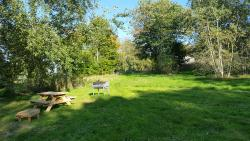 Picnic benches & fire pit for Ash Yurt