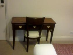 Desk with back to light and window