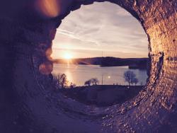 Sunset from the Lighthouse porthole window