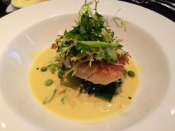 Cod on a bed of spinach and green peas with curry