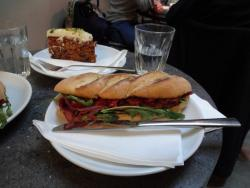 Baguette sandwich with roast beef, sun dried tomatoes and tapenade and carrot cake