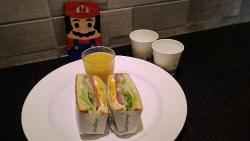 Breakfast! A sandwich they make fresh every morning for each guest. Served with a small glass of