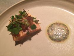 Gently poached trout, bog butter and porridge of lichens prepared in lye
