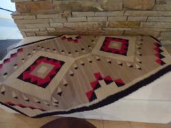 Navajo rug near the fireplace