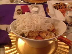 My entrée! Rice noodles with tofu in a spicy coconut curry sauce, garnished with noodle-like chi